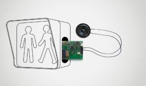 Schéma de l'insertion d'une carte électronique dans une figurine piéton